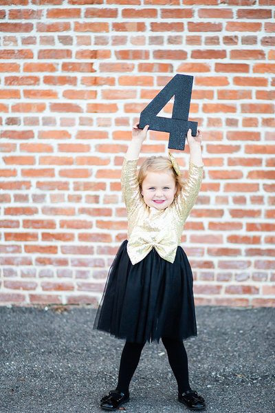 A little girl holds the number four for her birthday in Wauchula, Florida.