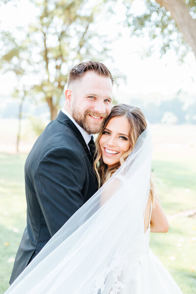 Joyful Romantic Portrait of Bride and Groom Smiling at Deer Flat Ranch Wedding Venue
