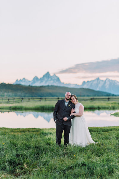 bride and groom wedding portrait grand teton national park wedding couple mountains  lake and green