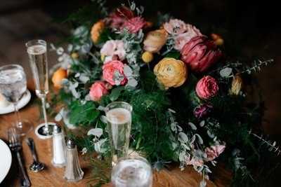 Wedding Reception head table with flower bouquet