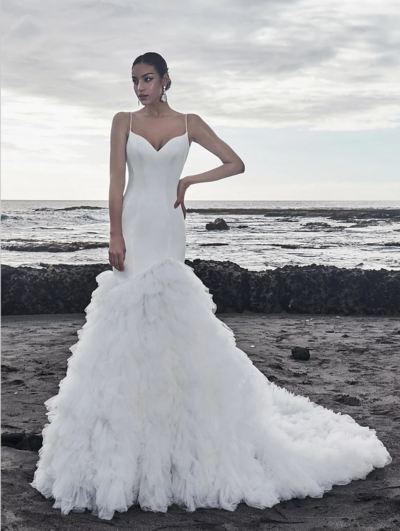 Ivory satin and tulle Mermaid silhouette Satin spaghetti strap V-neckline Sleek scooped back Cascading tulle train