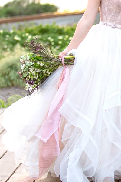 Beautiful wedding dress and bouquet on the beach in Santa Barbara, California