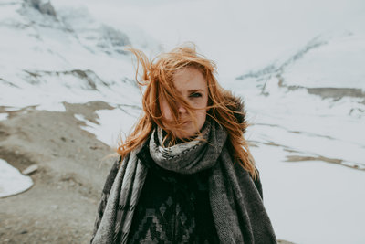 woman wearing scarf with mountains in background