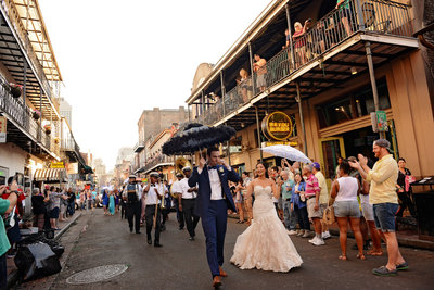 Bride and Groom Second Line Parade in New Orleans French Quarter