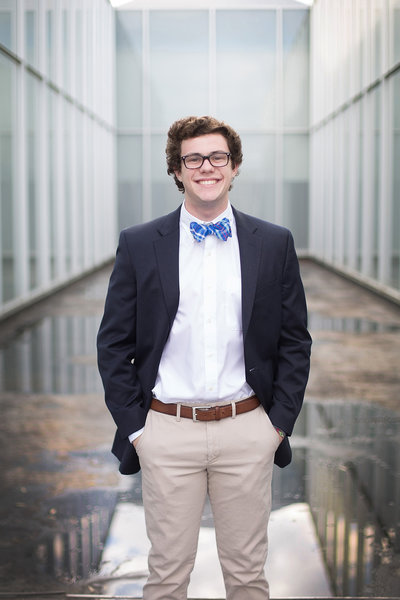 High school senior boy in sport coat and blue bow tie