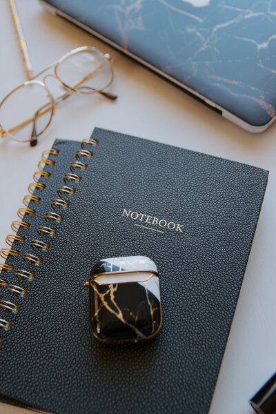 Brand photography flat lay of notebook and office details