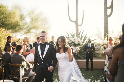 Lauren + Andrew's Four Seasons Scottsdale wedding was made beautiful with the help of these vendors: Some Like it Classic, Flowers by Jodi, Dolce & Gabbana,