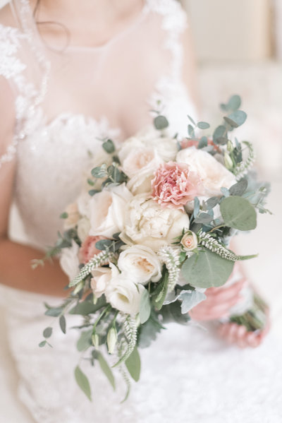 a charleston bride holding her wedding bouquet