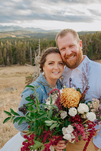 Bride and groom smile big for their sunset pictures after a wyoming mountain elopement package
