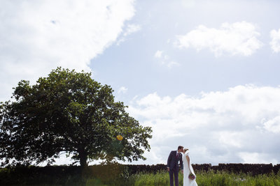 030-bride-and-groom-at-cheerful-chilli-barn--modern-wedding-photographer--leeds