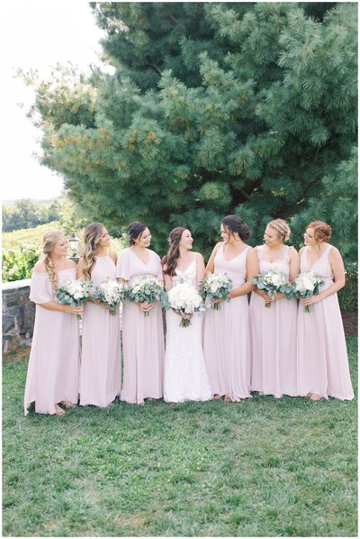 Bridesmaids and bride posing for wedding in Bluemont Virginia