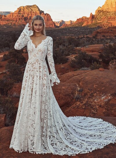 Ivory lace with soft floral motifs Sexy scoop back V-plunge neckline Lace sleeves Hem lace detailing