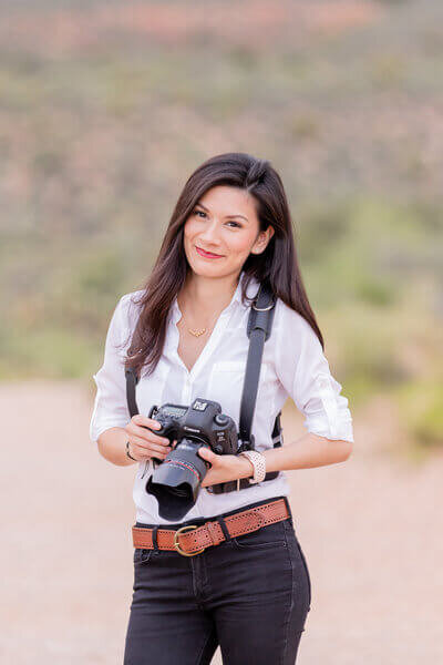 Ivette West Las Vegas Wedding Photographer holding a canon camera