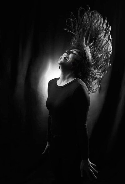black and white Atlanta studio portrait of girl flipping hair