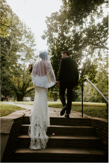 bride and groom walk up the stairs after their wedding ceremony at the woodend sanctuary in bethesda maryland