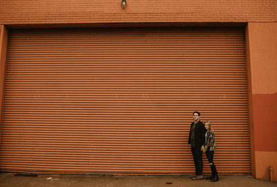 couple standing against wall