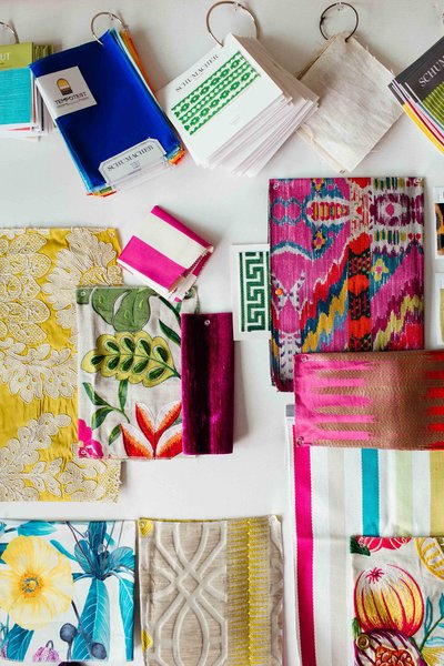 A color flat lay of patterned textiles and fabrics.
