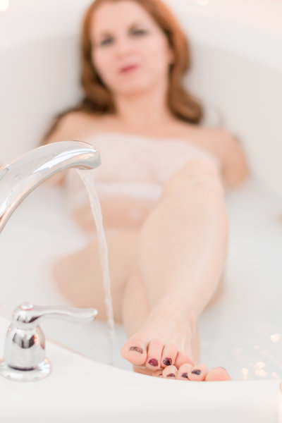 Boudoir Tub Shot with woman out of focus, but water and tippy toes in focus