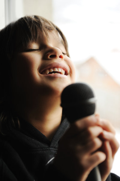 photodune-4838830-musician-kid-singing-with-microphone-m