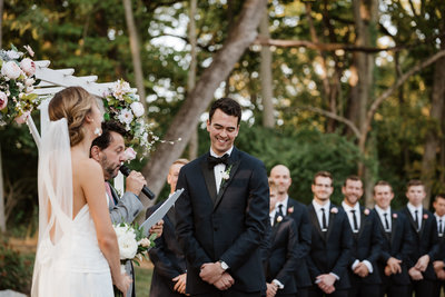 A groom blushes during his wedding ceremony in Bluemont Virginia