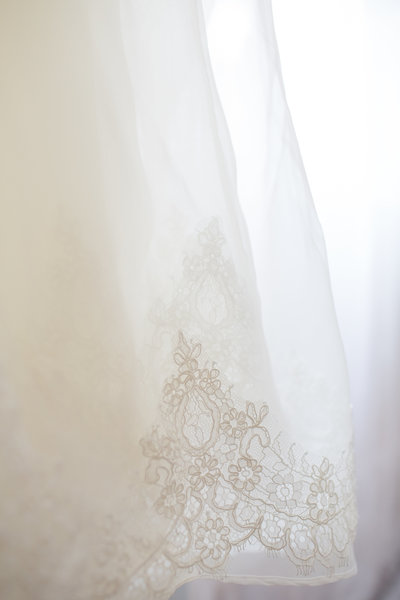 close up photo of lace detail on wedding dress in st louis