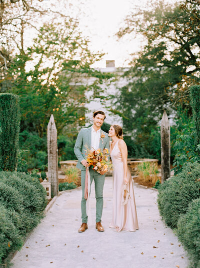 Just married couple outdoors at Wavering Place, Charleston