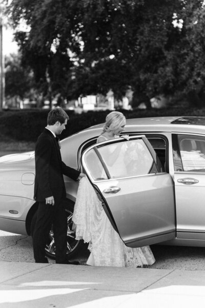 bride and groom get into car
