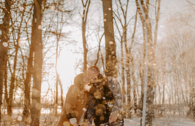 Couple throwing snow