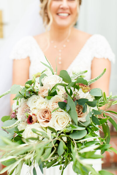 Bride holding her white and blush bouquet on her wedding day