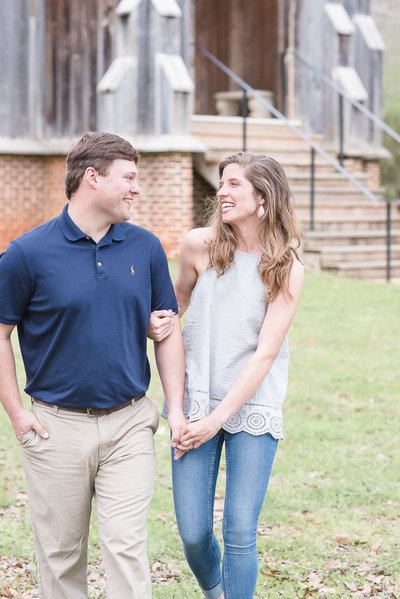 Couple laughing and walking at Old Cahawba engagement session