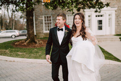 happy candid couple walking together at february nashville wedding at richland country club