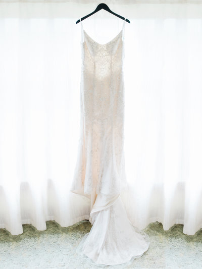 wedding dress framed in window