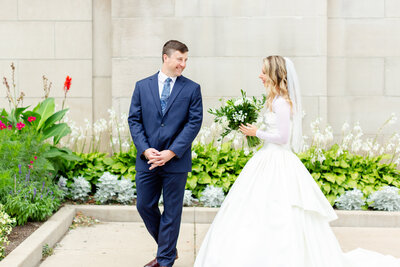 Bride and groom share a first look outside of St. Agnes in Saint Paul