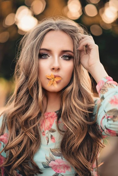 FREE STOCK PHOTO pretty girl with flower in her mouth