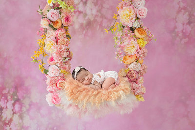 newborn in flowers247