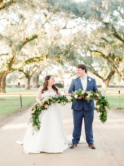 Bride and Groom with Greenery and Floral Garland and Boone Hall Plantation Avenue of Oaks Wedding