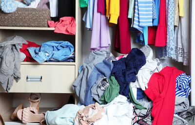 Clothes on the floor of the closet