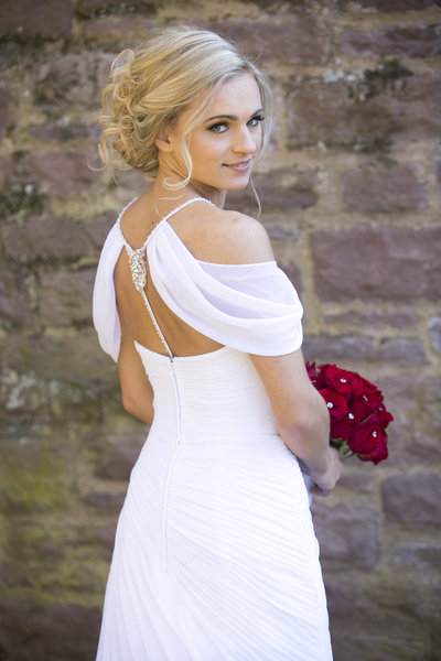 Bride in David's  Bridal Dress red rose bouquet