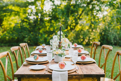 table setting with peaches & white plates