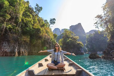 photo-of-woman-sitting-on-boat-spreading-her-arms-1371360