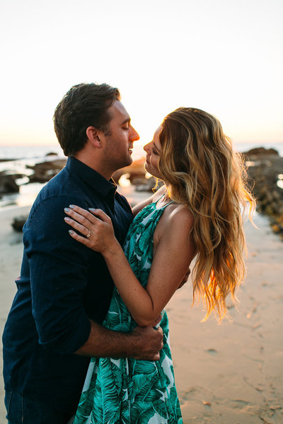beach waves during couples engagement photos