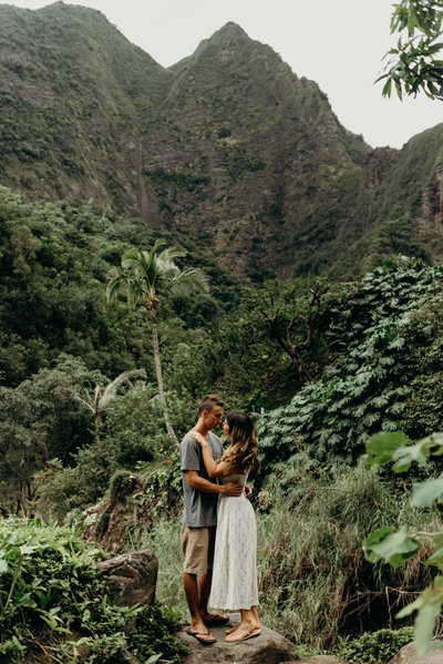couple hugging in jungle