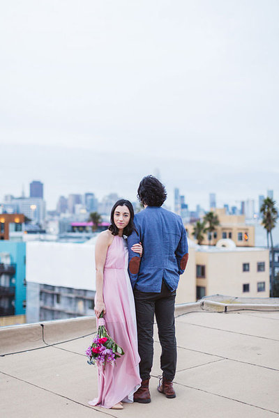 engaged couple overlooking san francisco skyline
