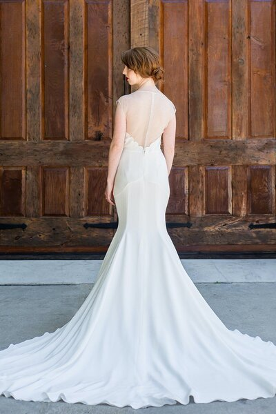 Back view of the Zara crepe wedding gown with its illusion back from the Classics bridal collection