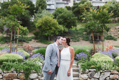 groom kissing bride at oakland wedding by Zoe Larkin Photography