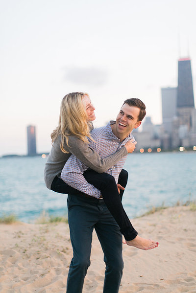 Couple pose for engagement photo at North Avenue Beach
