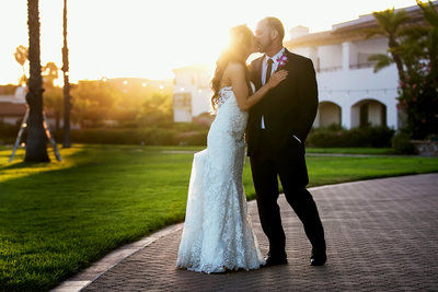 couple kiss sunset wedding portrait santa barbara fess parker wedding