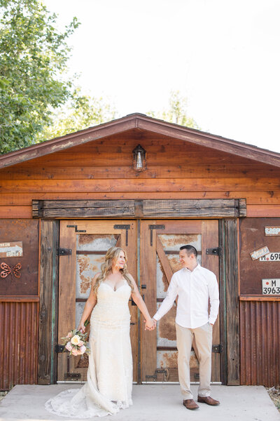 Couple stands in front of barn at their Sedona elopement