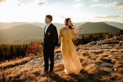 bride and groom standing on a mountain top