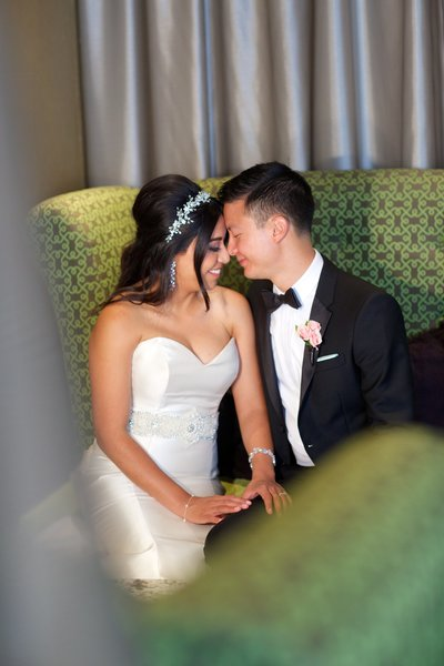 Bride and Groom sitting in green chair at The University Club